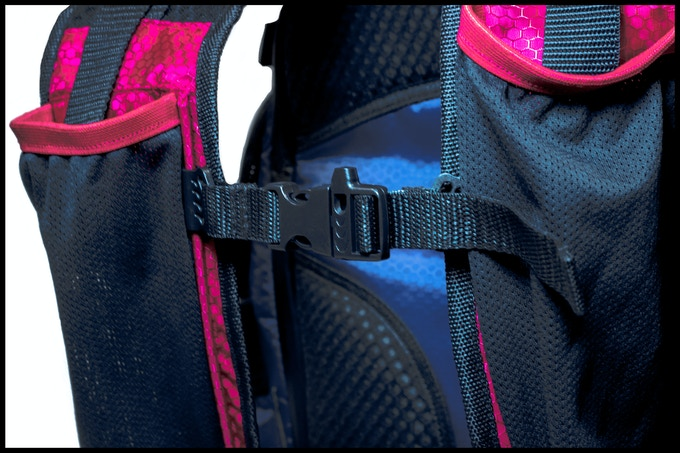 Adjustable sternum straps on sliders with integrated safety whistle