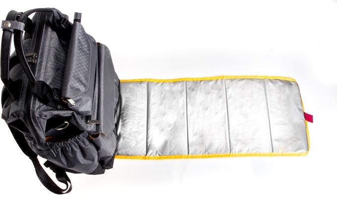Detachable, padded & water resistant diaper mat / ground mat
