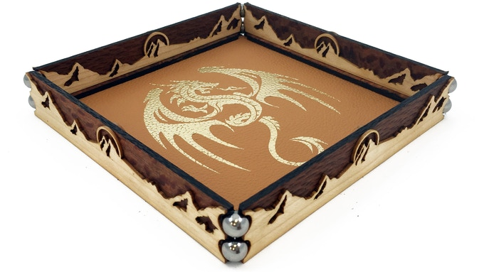 Leopardwood's eye-catching interwoven grain illuminates the smooth Maple accent. Shown: Winged Dragon art in gold foil pressed onto sandstone leather with Mountain flourish. FACT dragons love mountains.