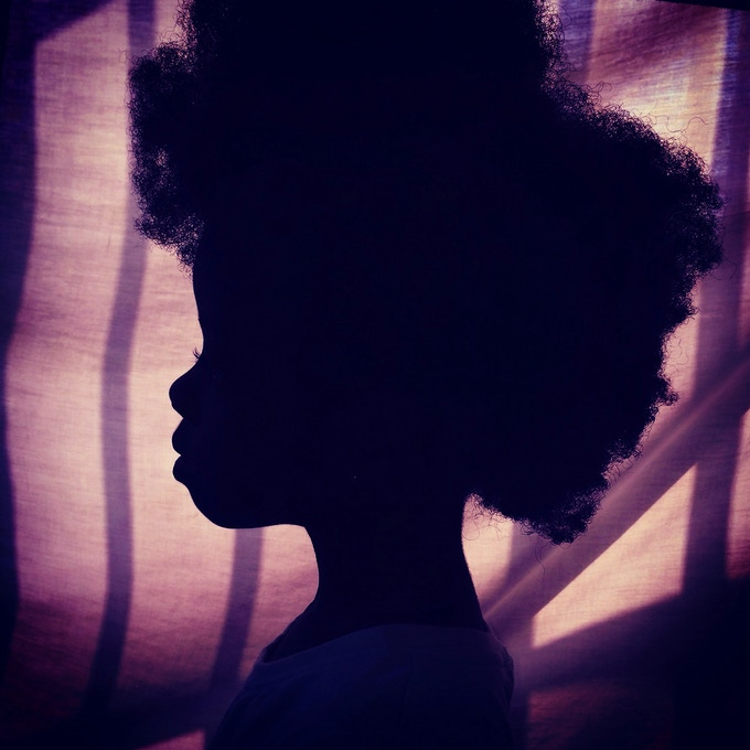 Afro on purple. Silhouette of my daughter. Accra, Ghana. Photo by Nana Kofi Acquah @africashowboy