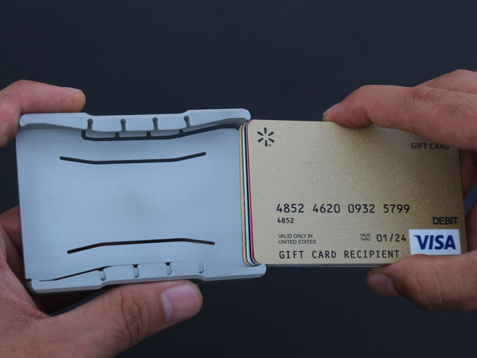 The side walls will flex open and retract once the cards are fully inserted