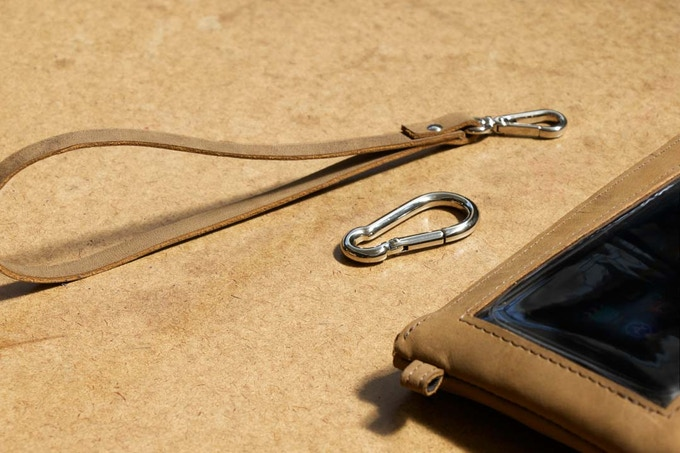 Just added! Optional Attachment Kit with matching leather wrist loop and caribiner