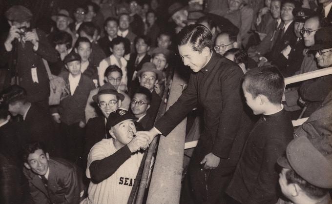 Lefty O'Doul greeting the Crown Prince Akihito (current Emperor of Japan). Courtesy of Dempsey family.