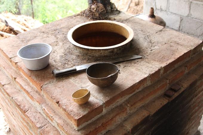 Xicaras, machete and an open still of Tio Pedro