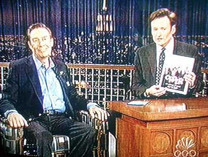 """A bemused Jerry Orbach is shown the """"Law & Order"""" coloring book on """"Late Night w/ Conan O'Brien."""""""