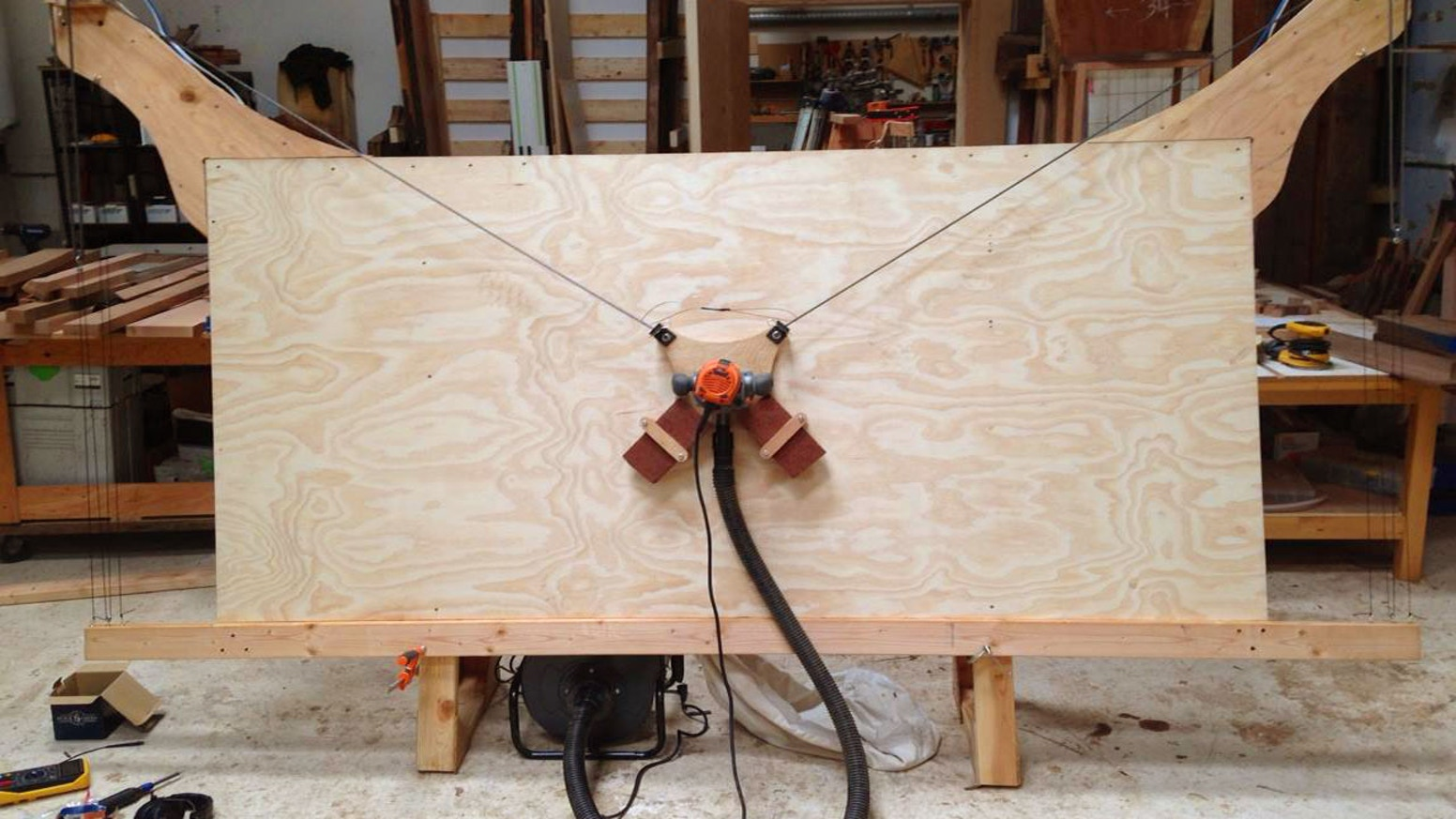 An open source 4 by 8 foot CNC cutting machine for under $500. A router designed to let you cut big, useful things out of wood and more