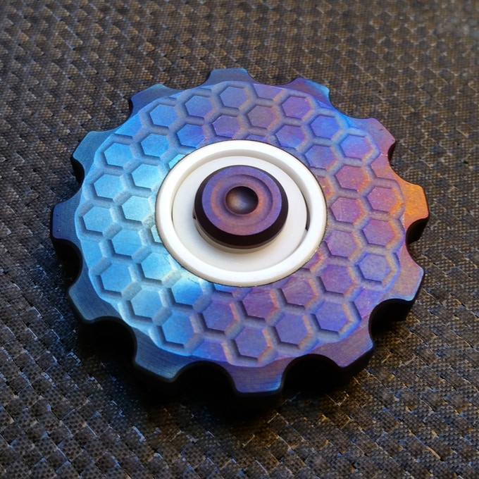 Titanium Cognito, flame anodized with a honeycomb engraving