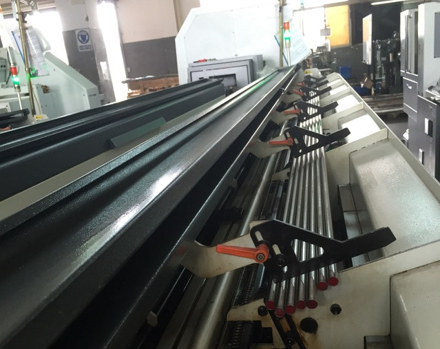 The steel rods are loaded onto the CNC machine so the machine can automatically feed them in. Just like the paper tray on a printer!
