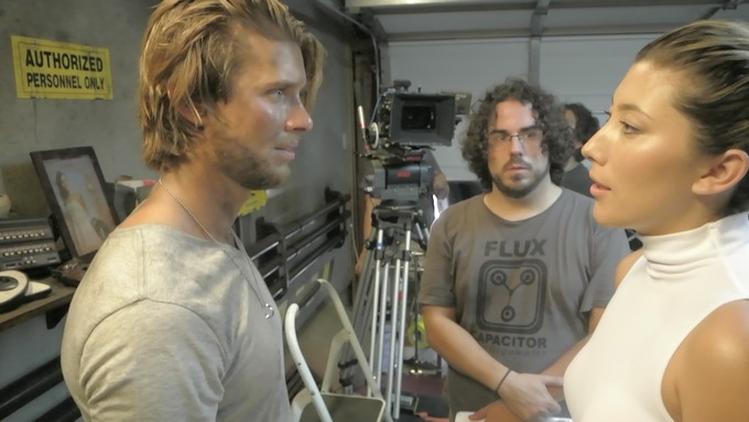 Director Nick Delgado supervises a rehearsal between Drew Van Acker (James) and Dichen Lachman (Kitty)