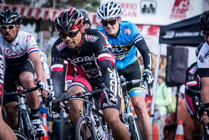 Dennis is an avid endurance athlete.  This is a photo of him competing in a criterium race for SDBC.