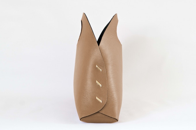 c0d30658bfc This is a medium size, it's like carrying a satchel or small tote, but the  look of this bag is truly a showstopper. Our Reversible Clutch.