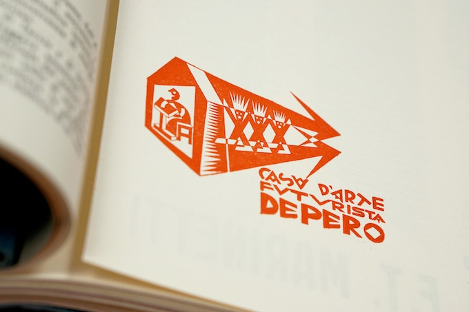 Logo for Depero's Futurist House of Art, which the artist established in 1919 in his native town of Rovereto, Italy, as a workshop for his Futurist projects.  Detail from The Bolted Book. Photo: Adam Reich