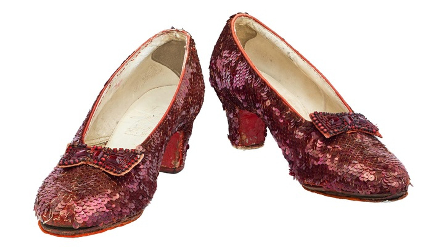 A community of backers around the world came together to help the Smithsonian conserve and display the Ruby Slippers and Scarecrow costume.