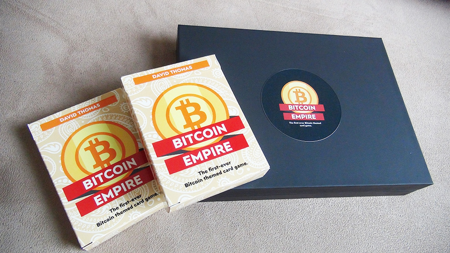 Build your crypto-currency empire and sabotage your opponents. A deck building, card game. 2-4 players. 15 minutes.