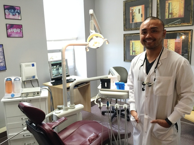 Carlo Ricafort, RDH with the Pocket Flosser prototypes in his dental office.