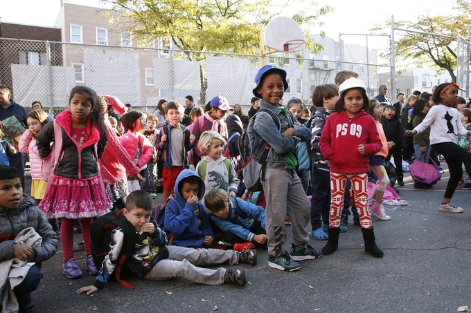 Children at PS 10 Await Les Vilains Chicots in 2015
