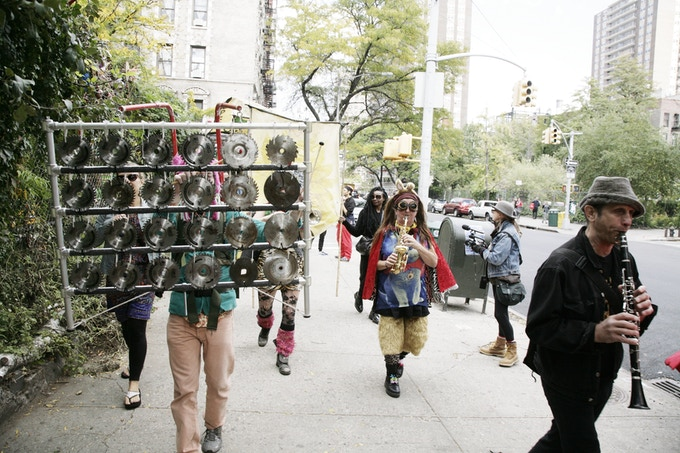 Kyle Davison & His Pristophonium - an instrument he built from saw blades - march down Ave. C in 2015 HONK! for More Gardens, along with Mel Mo Wish, from HONK OZ!