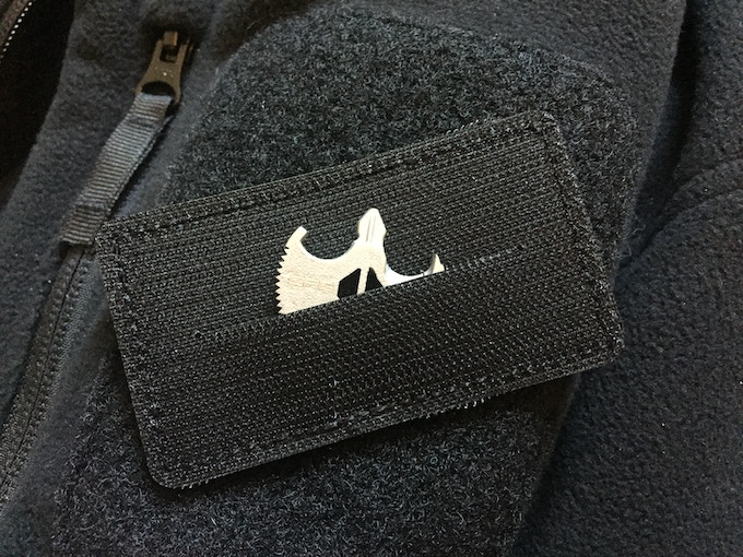 Back side of a sneaky patch with a pocket for the B.A.T. in it.  Subtle CPG logo on front.