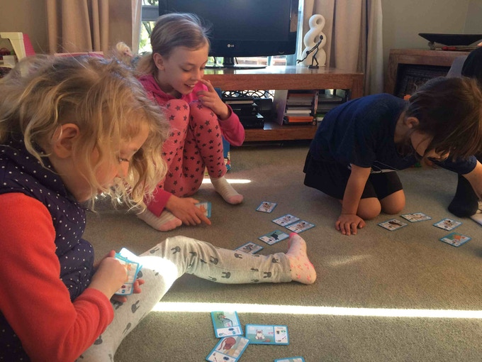 Some children playing with the Cat Maths cards