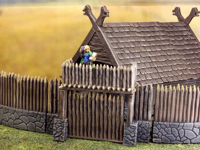 The terrain for the viking village includes a palisade