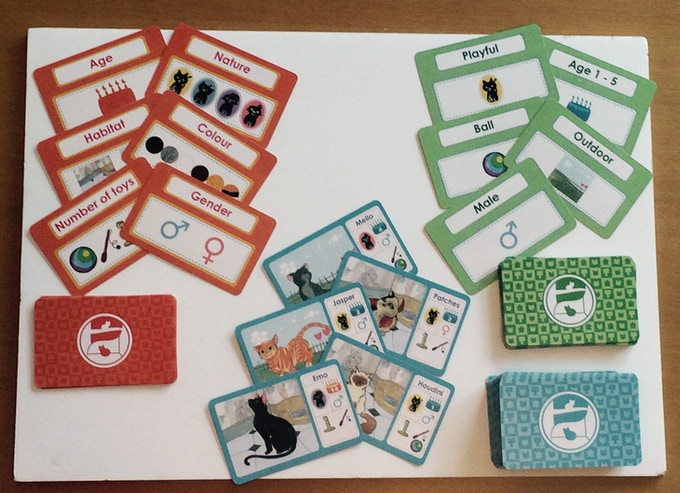 A full set of Cat Maths Cards -  12 Orange Attribute cards, 27 Green Value cards and 75 Blue Cat cards