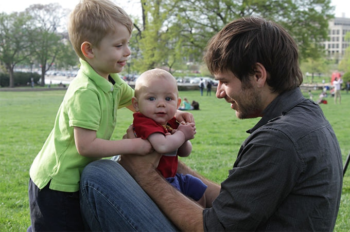 Director Brendon Marotta hanging out with an interview subject's kids at Genital Integrity Awareness Week in Washington, DC.