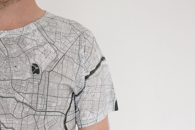 No street names are shown, giving each map T-shirt a minimal, pure feel.