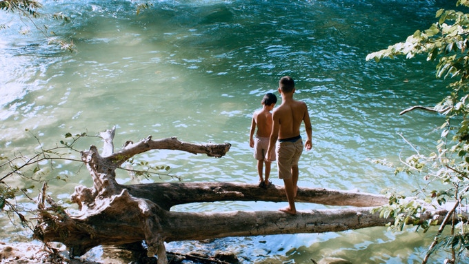 Kerry Landero, as Yochi, and Evan Martinez, as Itza, just before they jump into the river.