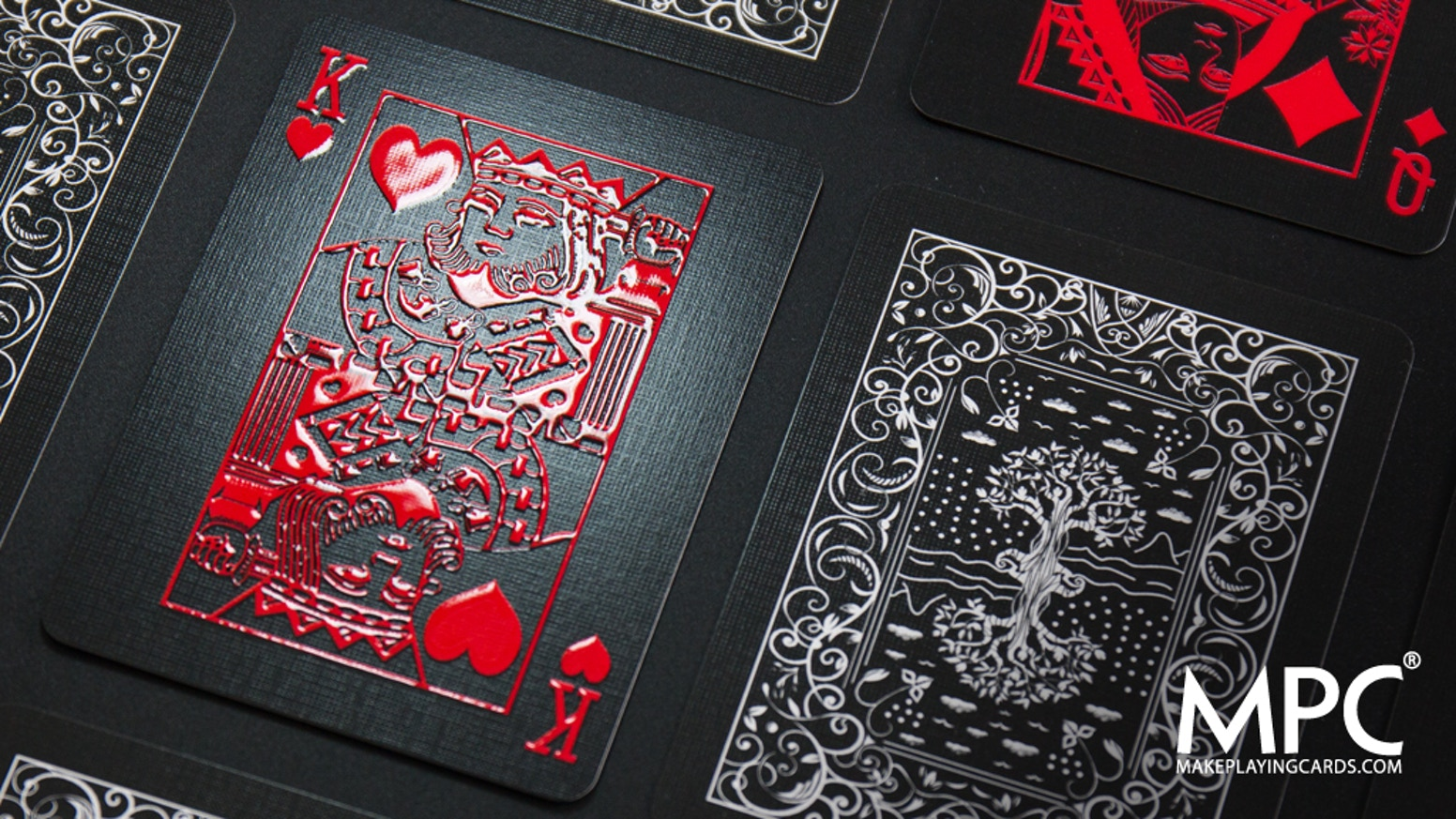 Touch and feel the artwork on a deck of playing cards produced using revolutionary state of the art raised gloss embossed technology.