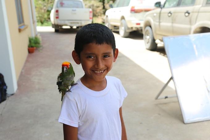 Kerry befriends a bird at Belize Bird Rescue.