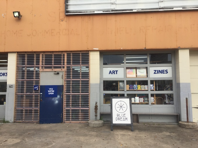 """May Gallery""""s Deceiving store front. Once you go through this door you'll find a massive ever-changing contemporary space & dreamland."""