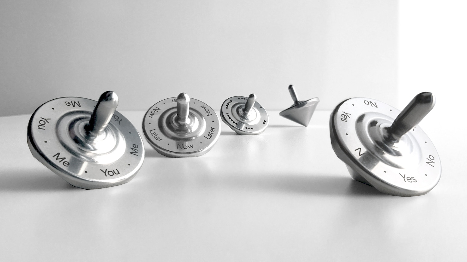 Precise, perfectly-balanced, stainless steel spinning tops designed to make everyday decision-making more fun!