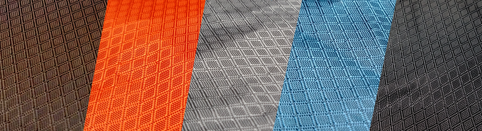 Fabric is available in Brown, Orange, Grey, Blue, or Black, as shown in that order.