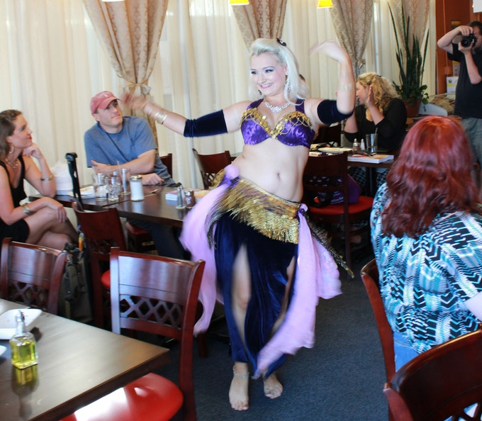 "Author Poppy Maya performing at the Kabob House in Sunnyvale, CA wearing a design she created for the cover of our book ""Becoming a Belly Dancer"""
