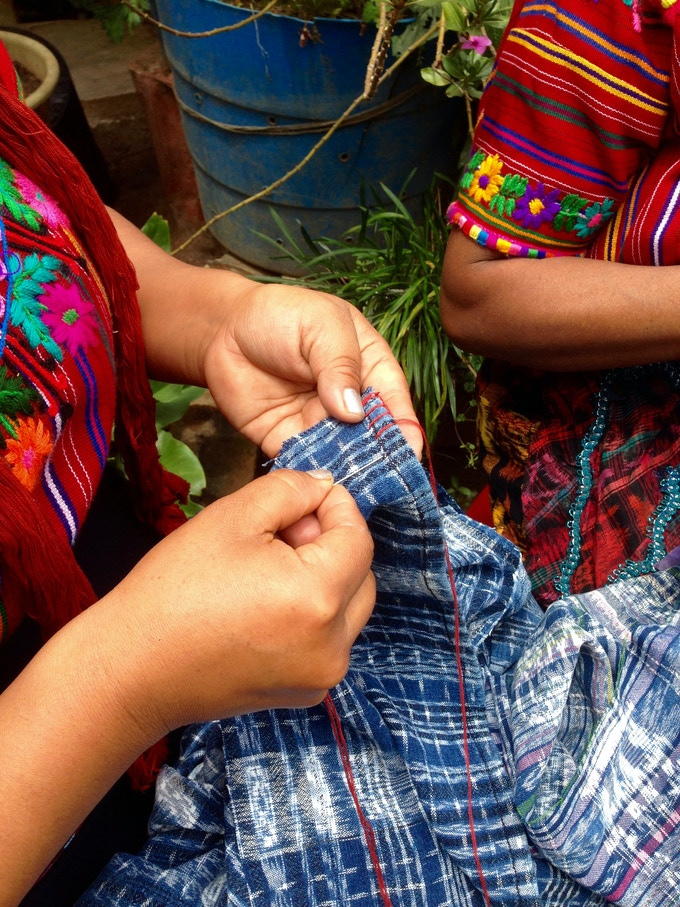 Our embroidery artisans work stitch by stitch using naturally-dyed thread prepared by our partner weavers.