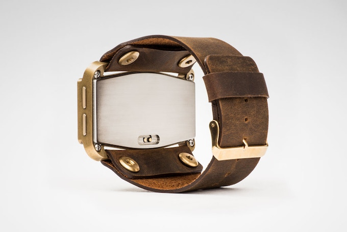 Snake Edition with brown leather strap and brass accents.