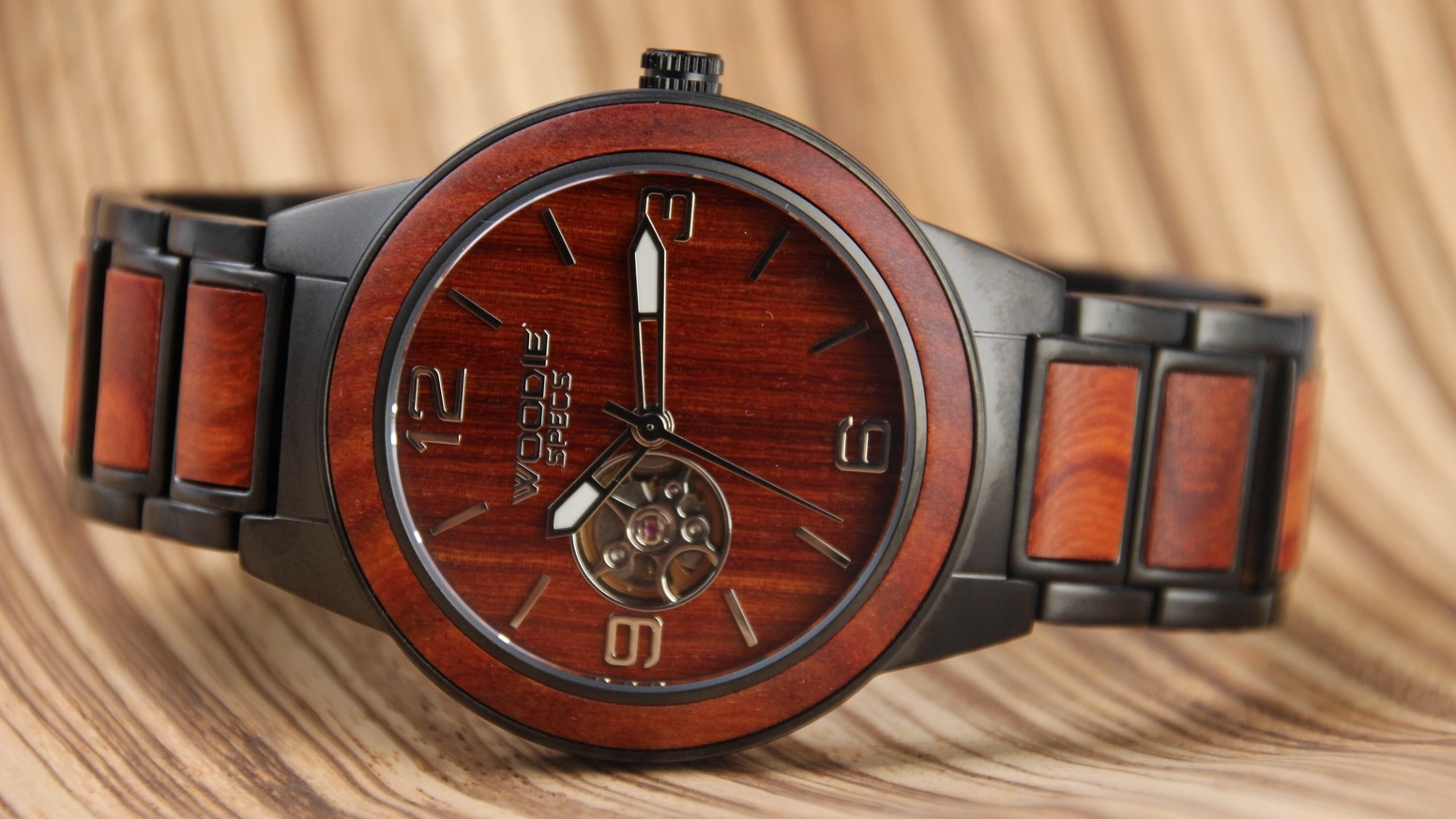 Handcrafted wood watch features stainless steel, sapphire glass, and high-quality automatic movement that requires no battery.