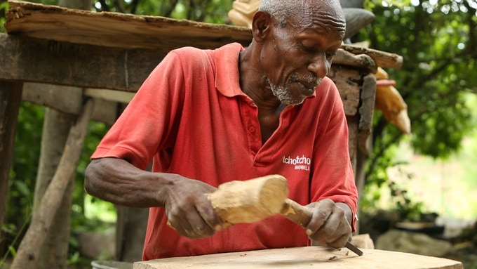 Legendary Haitian wood carver Bonsy. Artists and craftsmen from the region have created almost all of the rewards which will help build this home.