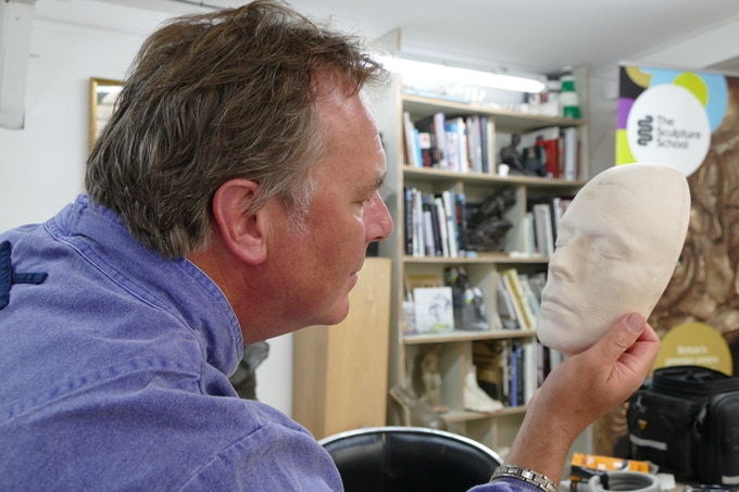 Sculptor Andrew Sinclair with the mask taken from Bowie's face during the filming of 'The Man who Fell to Earth'.