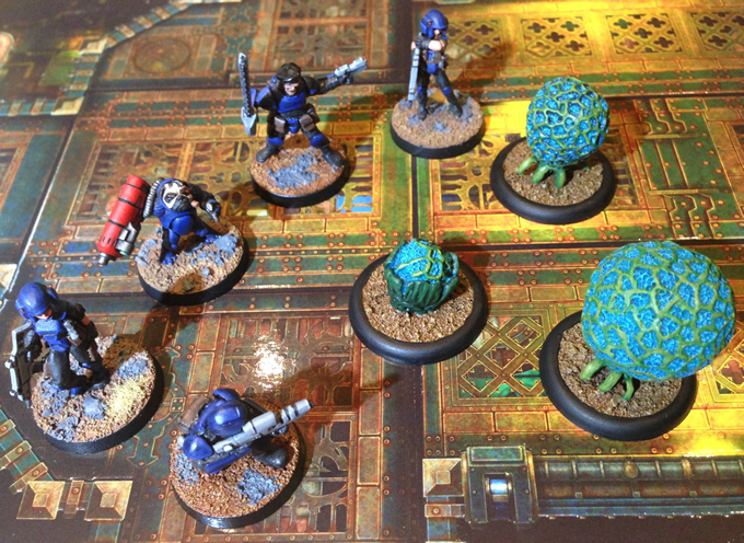 Cirripods attack a group of Heresy Miniatures