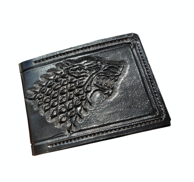 Carved hand painted leather wallets by stephen