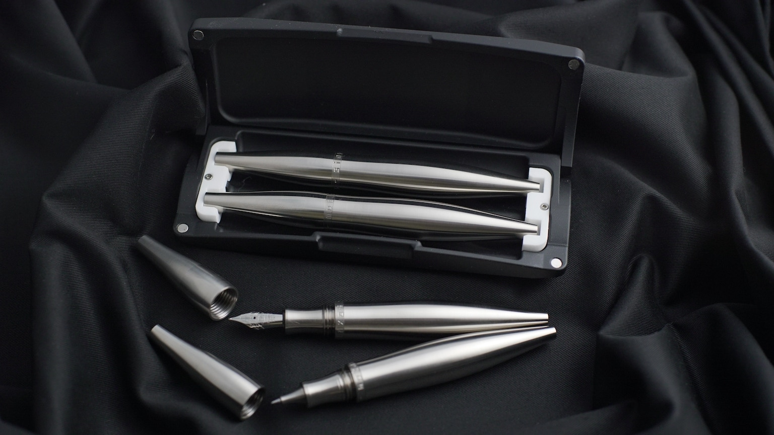 The ultimate gift - Two indestructible TITANIUM ,curvaceous, ink fountain & rollerball/fineliner pens in a solid, cnc-machined capsule.