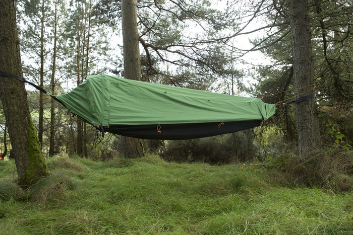 Tent / Hammock lets you sleep high or low; designed with built-in insulated air mattress, detachable sleeping bag & dual connectability