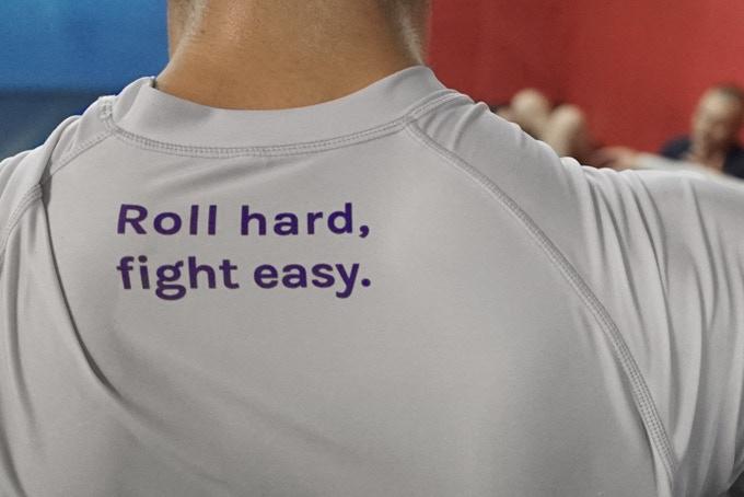Roll rashguard back