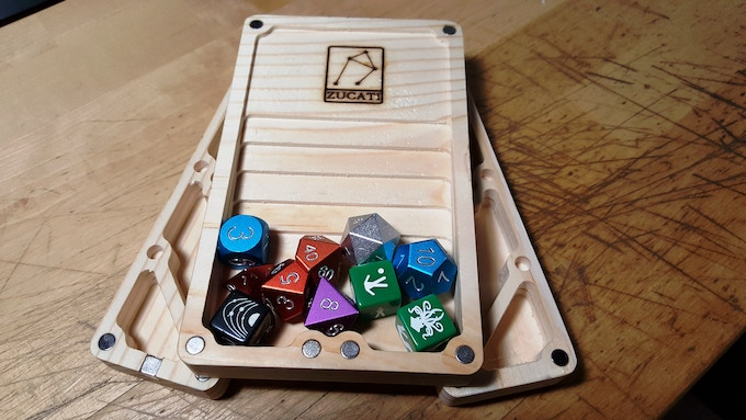 Just like it works as a clamshell storage case for your dice, pens, paper, and minis... the parts stow on the OUTSIDE too! Just want a compact rolling tray with cool steps and a nice big landing area? You got it... The rest stows underneath.