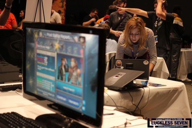 An attendee fills out the player survey after spending some time with the game.