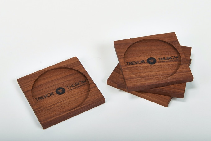 Spice up your coffee table with this set of 4 handmade walnut coasters