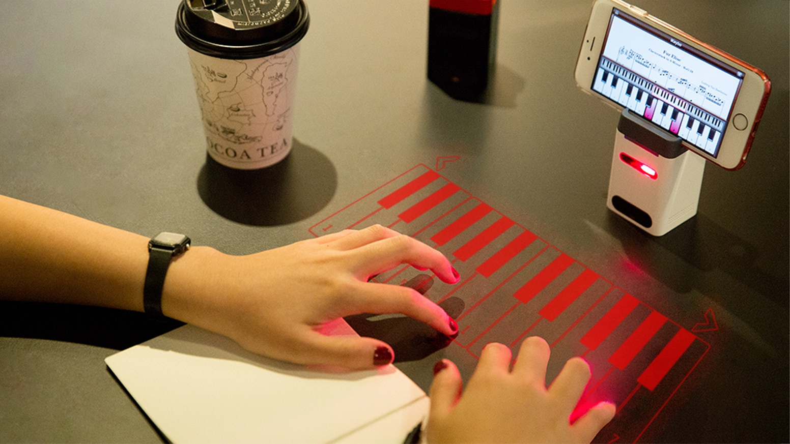 The world's first virtual laser projection multilingual keyboard, virtual piano, and portable charger. All Together.
