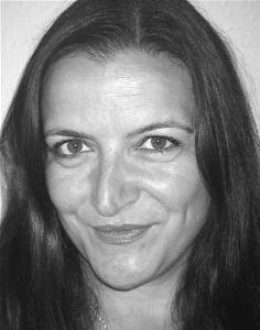 Lucy Christy, known for stage classics such as Oedipus, Ajaz and Macbeth and television appearances including the Bill, as Boss