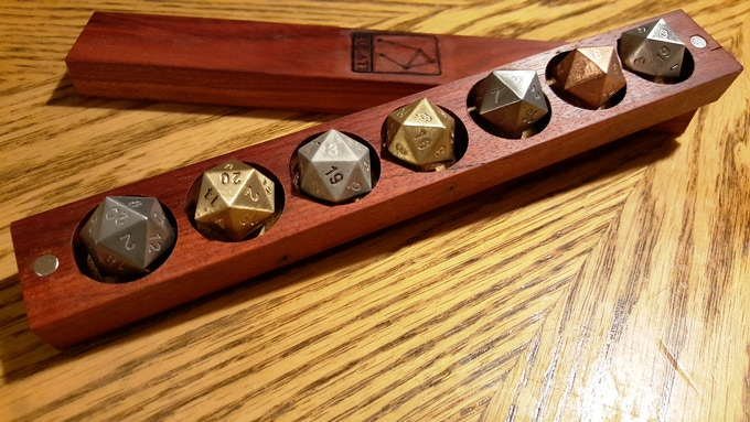 D20 with Blood Wood Dice Base One. One each of 7 metals.